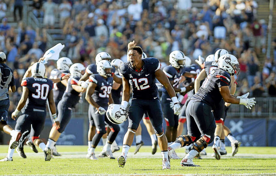 UConn's E.J. Levenberry (12) celebrates after the Huskies win over Virginia on Sept. 17. Photo: The Associated Press File Photo  / FR125654 AP