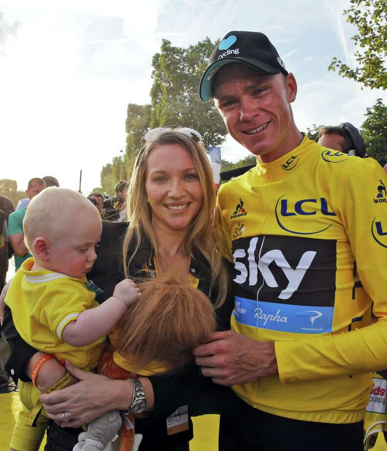 2016 Tour de France winner Chris Froome of Britain, his wife Michelle and their son Kellan pose for photographers after the twenty-first and last stage of the Tour de France cycling race in Paris, France on July 24, 2016. Photo: AP Photo/Christophe Ena  / Copyright 2016 The Associated Press. All rights reserved. This material may not be published, broadcast, rewritten or redistribu