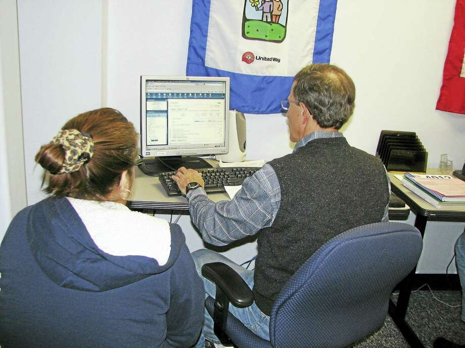 Volunteer Jay Keiser works on taxes at the Volunteer Income Tax Assistance site at the Middlesex United Way in Middletown. Photo: Courtesy Photo