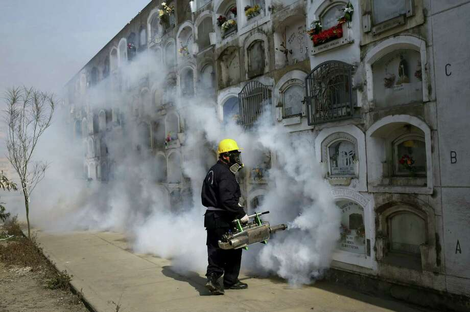 A health worker fumigates to prevent, Dengue, Chikunguya and Zika virus, at El Angel cemetery, in Lima, Peru, Wednesday, Jan. 20, 2016. A U.S. warning urging pregnant women to avoid travel to Latin American countries where the mosquito-borne virus is multiplying threatens to depress tourism to the region, one of its few bright spots at a time of deep economic pain. Photo: AP Photo/Martin Mejia   / AP