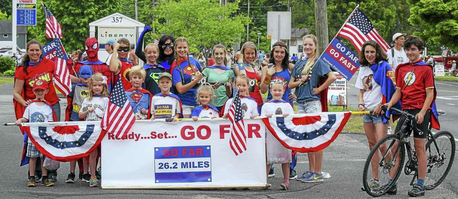 Go Far, Go Fast founder Jennifer Schulten (far left) of Middlefield is among six winners of the  2016 John Wentworth Good Sports Award given by the Connecticut Sports Writers' Alliance. Here, those who took part in the Memorial Day 2015 superheros-themed race are members of the popular running group that operates in several Regional School District 13 schools. Photo: Jennifer Schulten