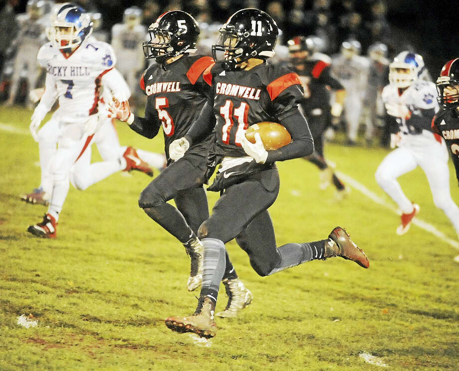 Cromwell/Portland receiver Dianta Highsmith looks for some running room against Rocky Hill on Wednesday night. Photo: Jimmy Zanor - The Middletown Press