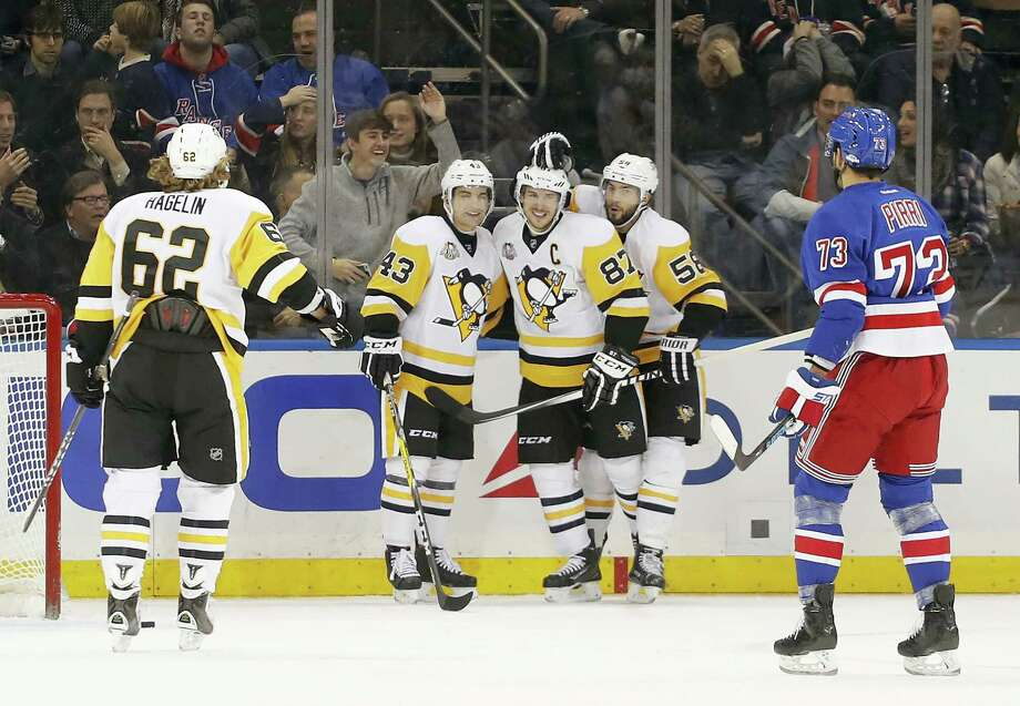 Pittsburgh Penguins center Sidney Crosby (87) is congratulated by teammates after scoring a goal against the New York Rangers during the second period of an NHL hockey game, Wednesday in New York. Photo: Julie Jacobson — The Associated Press  / Copyright 2016 The Associated Press. All rights reserved.