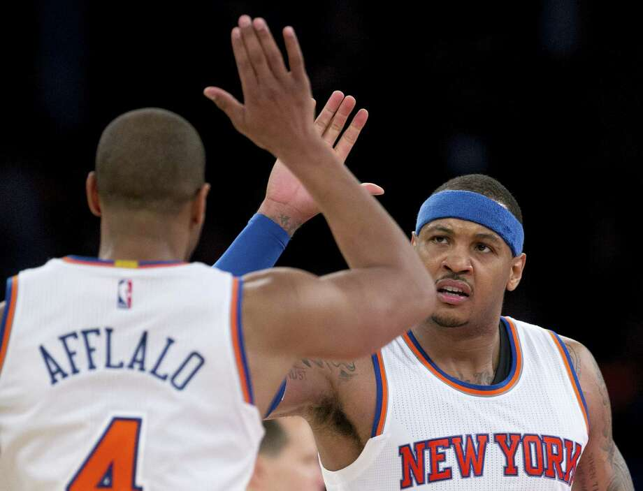 New York Knicks forward Carmelo Anthony, right, congratulates guard Arron Afflalo (4) after Afflalo hit a 3-point shot against the Utah Jazz late in the fourth quarter of an NBA basketball game, Wednesday, Jan. 20, 2016, in New York. The Knicks won 118-111 in overtime. (AP Photo/Julie Jacobson) Photo: AP / AP
