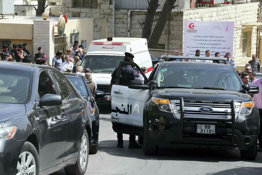An ambulance transports the body of Jordanian writer Nahed Hattar to a medical facility, after he was shot, in Amman, Jordan on September 25, 2016. The prominent writer was shot dead in front of the courthouse where he was on trial for sharing a cartoon deemed as offensive to Islam. Photo: AP Photo/Raad Adayleh  / Copyright 2016 The Associated Press. All rights reserved.