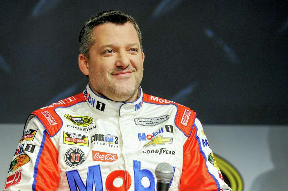 Tony Stewart talks to the media during the NASCAR Charlotte Motor Speedway Media Tour in Charlotte, N.C., on Thursday. Photo: Mike McCarn — The Associated Press  / FR34342 AP
