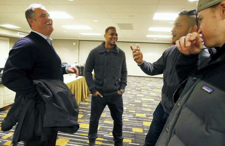 Red Sox manager John Farrell, left, jokes with players, from left, Xander Bogaerts, Eduardo Rodriguez and Brock Holt during a media availability prior to the Boston chapter of the Baseball Writers Association of America's awards dinner Thursday in Boston. Photo: Michael Dwyer — The Associated Press  / AP