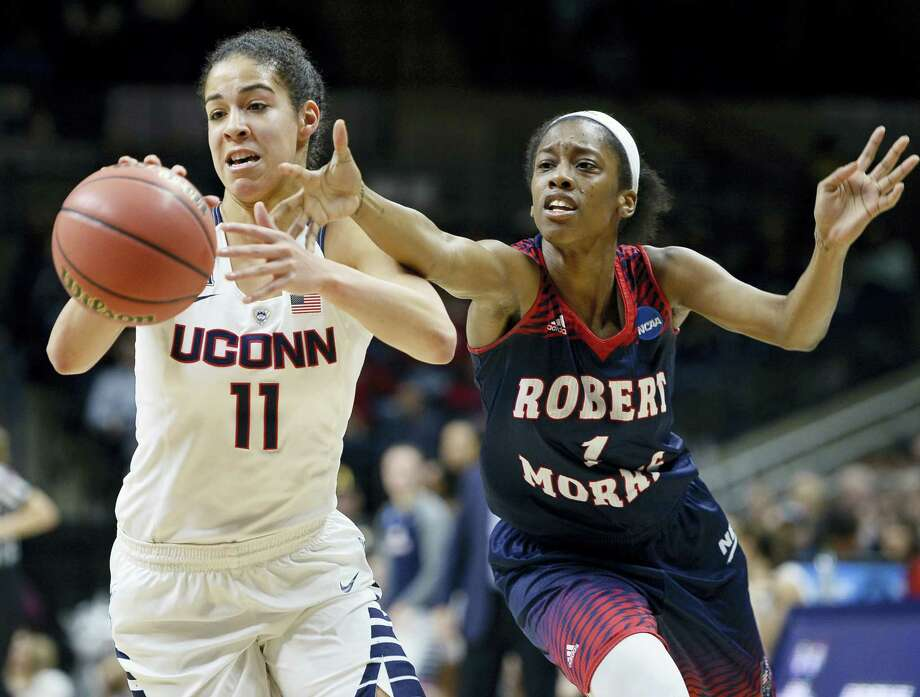 Connecticut's Kia Nurse, left, steals the ball from Robert Morris' Jocelynne Jones, right, during a first round women's Saturday in Storrs. Photo: Jessica Hill — The Associated Press  / FR125654 AP