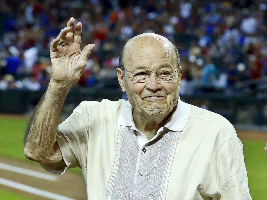 FILE - In this April 14, 2013, file photo, Arizona Diamondbacks broadcaster Joe Garagiola, center, waves to a cheering crowd during festivities honoring the retiring broadcaster, prior to a baseball game against the Los Angeles Dodgers, in Phoenix. Former big league catcher and popular broadcaster Joe Garagiola has died. He was 90. The Arizona Diamondbacks say Garagiola died Wednesday, March 23, 2016. He had been in ill health in recent years. (AP Photo/Ross D. Franklin, File) Photo: AP / AP