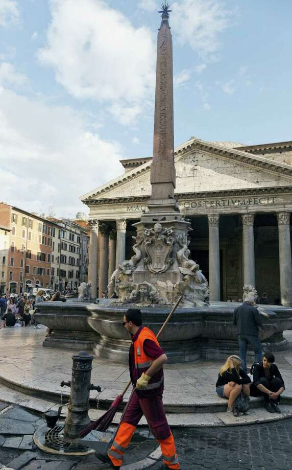 """AP Photo Domenico/Stinellis  A street cleaner sweeps around the Fountain of the Pantheon in downtown Rome, Tuesday, May 24, 2016. The fountain, designed around mythological figures by different artists in the 16th and 18th centuries, is among the monuments that Rome is offering in a form of """"adoption"""" with a project called """"100 proposals for patrons,"""" seeking all the sponsors it can find to fund the monumental job of restoring and maintaining its hundreds of fountains, statues, archaeological sites and historic palazzos. Photo: AP / Associated Press"""