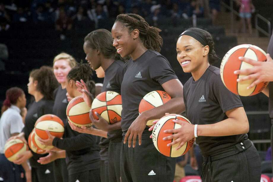 Mmembers of the New York Liberty basketball team await the start of a game against the Atlanta Dream, in New York earlier this month wearing plain black warm-up shirts. Photo: The Associated Press File Photo  / Copyright 2016 The Associated Press. All rights reserved. This material may not be published, broadcast, rewritten or redistribu