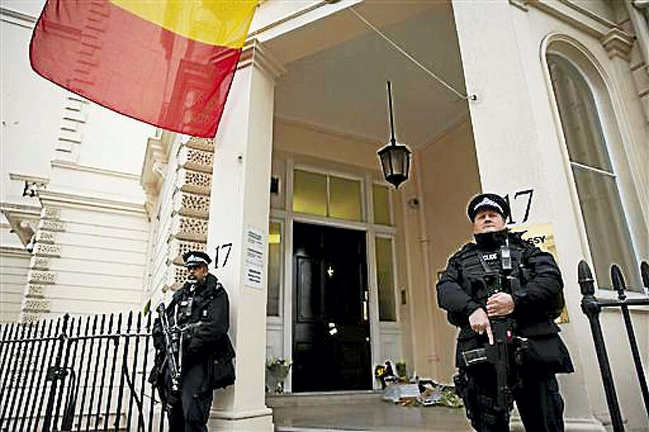 Armed British police stand guard outside the Belgian Embassy in London, Wednesday, March 23, 2016. Belgian authorities searched Wednesday for a man pictured at the Brussels airport with two apparent suicide bombers, amid growing suggestions that the bombings of the Brussels airport and subway were the work of the same Islamic State cell that attacked Paris last year. Photo: AP Photo/Matt Dunham   / AP