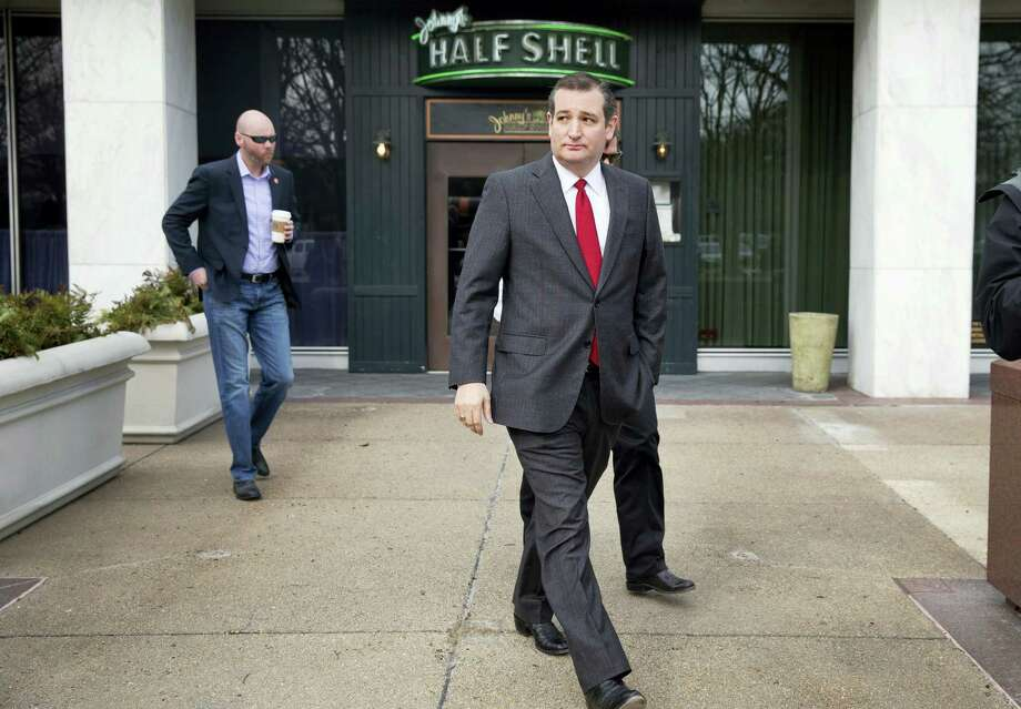 """Republican presidential candidate, Sen. Ted Cruz, R-Texas leaves after speaking to the media about events in Brussels on March 22, 2016 near the Capitol in Washington. Cruz said he would use the """"full force and fury"""" of the U.S. military to defeat the Islamic State group. Photo: AP Photo/Jacquelyn Martin  / AP"""