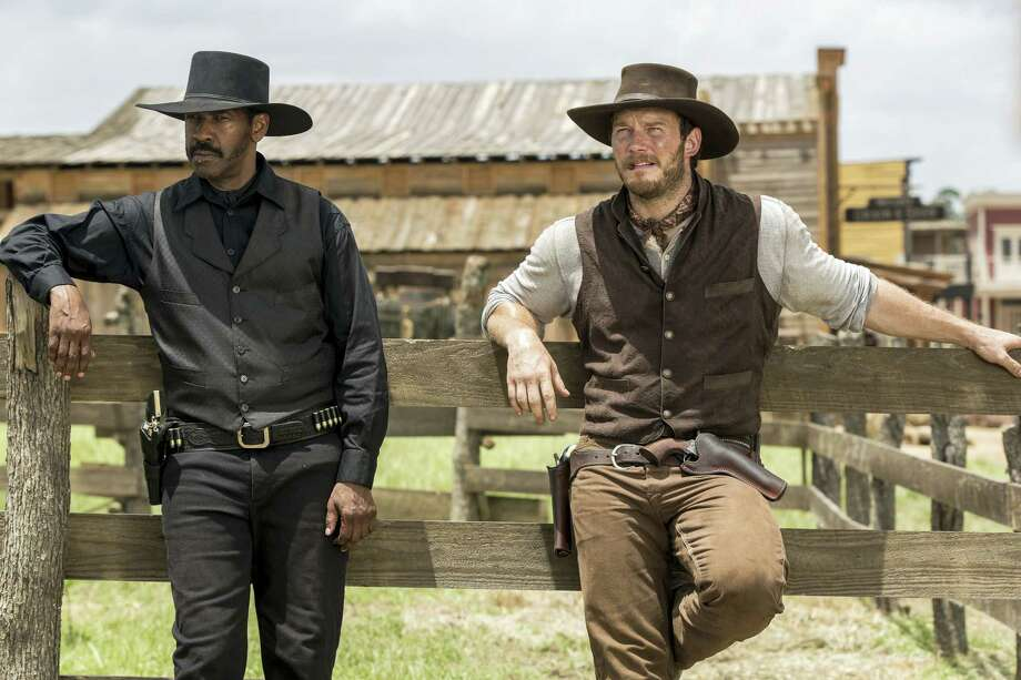 """In this image released by Sony Pictures, Chris Pratt, right, and Denzel Washington appear in a scene from """"The Magnificent Seven."""" Antoine Fuqua's """"The Magnificent Seven"""" remake rode the star power of Denzel Washington to an estimated $35 million debut, topping North American ticket sales over the weekend. Photo: Sam Emerson/Sony Pictures Via AP  / ©2016 Metro-Goldwyn-Mayer Pictures Inc. and Columbia Pictures Industries, Inc. All Rights Reserved. **ALL IMAGES ARE PROPERTY O"""