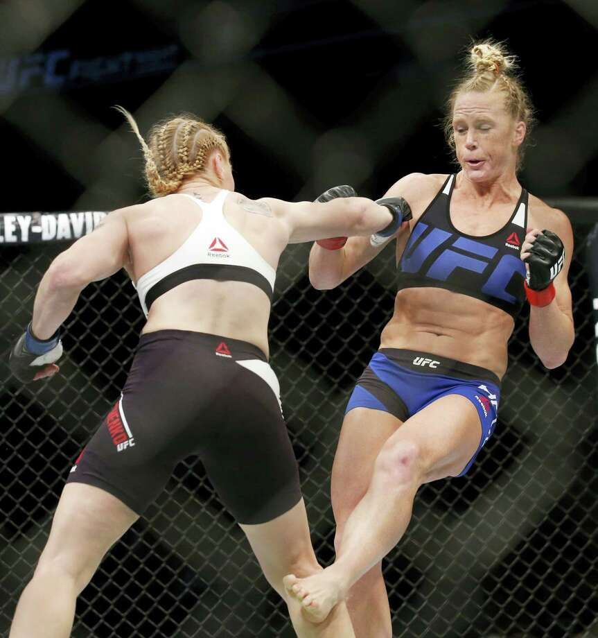 Holly Holm, right, tries to avoid a punch from Valentina Shevchenko during women's bantamweight mixed martial arts bout in Chicago on Saturday. Photo: Nam Y. Huh — The Associated Press  / Copyright 2016 The Associated Press. All rights reserved. This material may not be published, broadcast, rewritten or redistribu