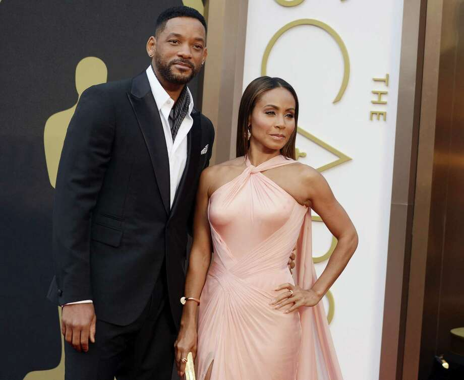 In this March 2, 2014 photo, Will Smith, left, and Jada Pinkett Smith arrive at the Oscars at the Dolby Theatre in Los Angeles. Smith said Thursday, Jan. 21, 2016, he will not attend the Academy Awards next month, joining his wife, Jada Pinkett Smith, and others in protest against two straight years of all-white acting nominees. Photo: Photo By Jordan Strauss/Invision/AP, File  / Invision