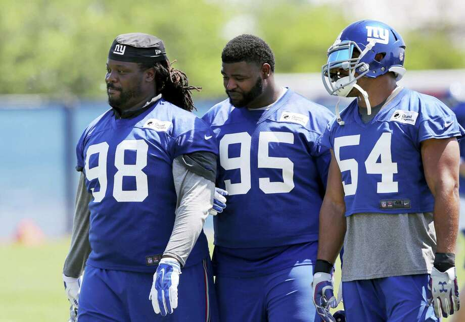 Giants defensive tackles Damon Harrison (98) and Johnathan Hankins (95) walk on the field with defensive end Olivier Vernon (54) during practice on Monday in East Rutherford, N.J. Photo: Mel Evans — The Associated Press  / Copyright 2016 The Associated Press. All rights reserved. This material may not be published, broadcast, rewritten or redistribu
