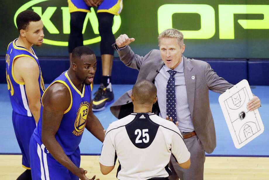 Warriors head coach Steve Kerr, right, and forward Draymond Green dispute a flagrant foul call on Green in the first half of Game 3 on Sunday. Photo: Sue Ogrocki — The Associated Press  / AP2016