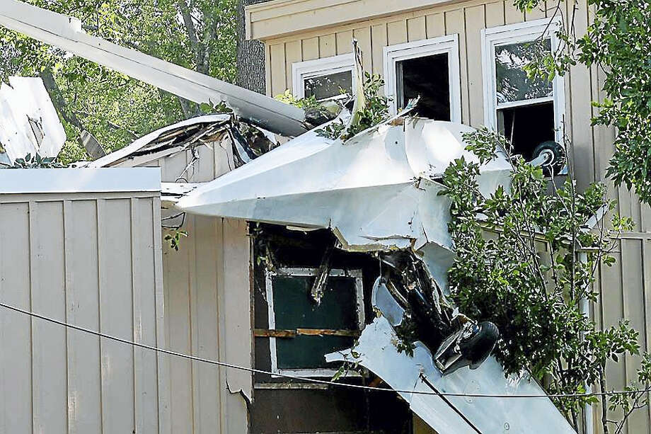 The pilot of a single-engine plane crashed his aircraft into a house on Little Meadow Road on Saturday in Haddam. Photo: Olivia Drake — Haddam Volunteer Fire
