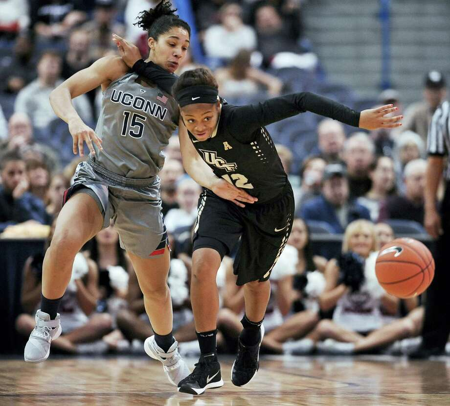 Connecticut's Gabby Williams, left, and UCF's Nyala Shuler, right, chase a loose ball during the first half Wednesday. Photo: JESSICA HILL — THE ASSOCIATED PRESS  / FR125654 AP