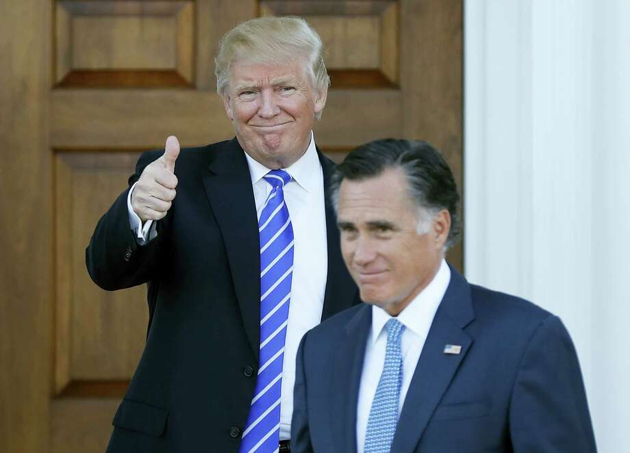 President-elect Donald Trump gives the thumbs-up as Mitt Romney leaves Trump National Golf Club Bedminster in Bedminster, N.J. on Nov. 19, 2016. Photo: AP Photo/Carolyn Kaster  / Copyright 2016 The Associated Press. All rights reserved.