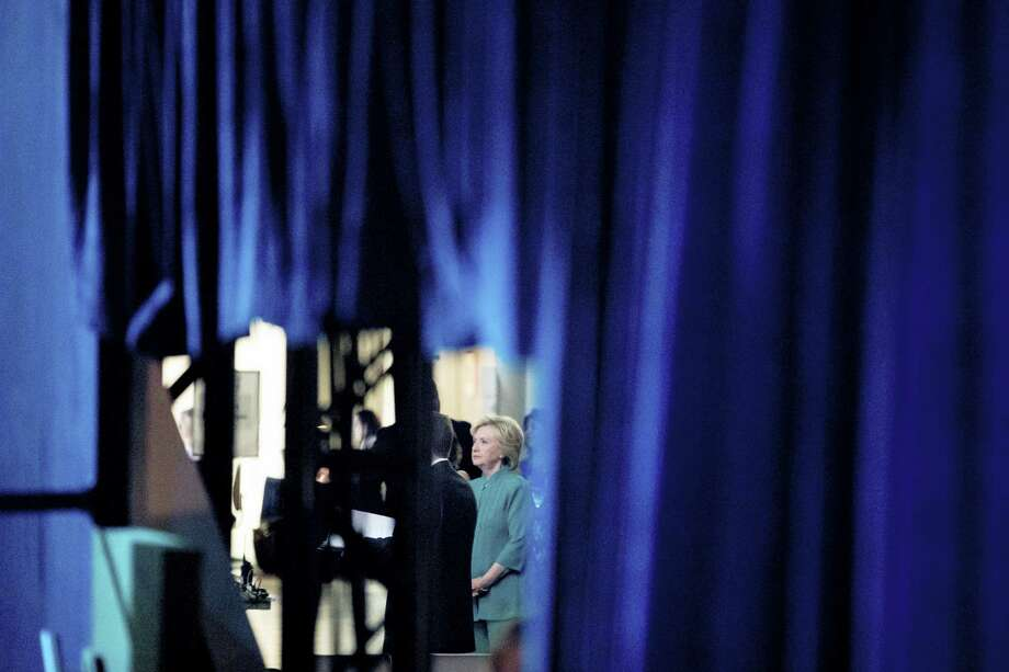 Democratic presidential candidate Hillary Clinton waits back stage before speaking at the American Federation of State, County and Municipal Employees 42nd International Convention at the Las Vegas Convention Center in Las Vegas, Tuesday, July 19, 2016. Photo: AP Photo/Andrew Harnik   / Copyright 2016 The Associated Press. All rights reserved. This material may not be published, broadcast, rewritten or redistribu