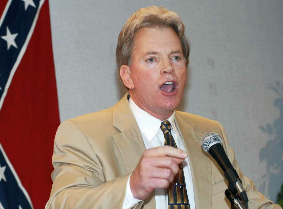 In this May 29, 2004, file photo, former Ku Klux Klan leader David Duke speaks to supporters in Kenner, La. Duke said he plans to run for U.S. Senate in Louisiana. Duke's announcement came Friday, July 22, 2016, on his website. Photo: AP Photo/Burt Steel, File   / Copyright 2016 The Associated Press. All rights reserved. This material may not be published, broadcast, rewritten or redistribu