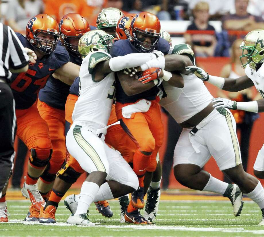 Syracuse's Dontae Strickland, center, gets past the South Florida defense earlier this season. Photo: The Associated Press File Photo  / FR171024 AP