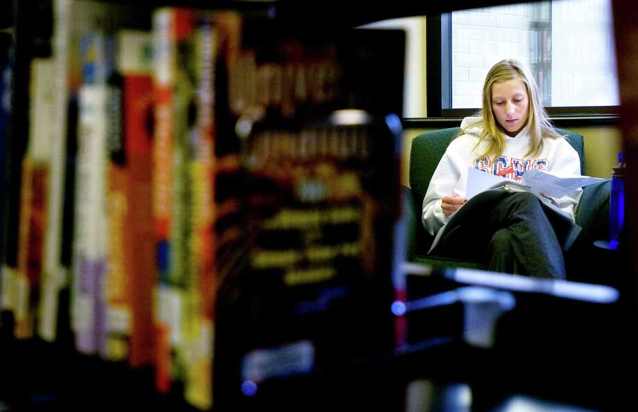 [LegacyArchive] Evening Sun Photo by Meghan Gauriloff Hanover resident Angela Davidson, a graduate student at Hood College, studies for an exam Monday at Guthrie Memorial Library in Hanover. Photo: File Photo