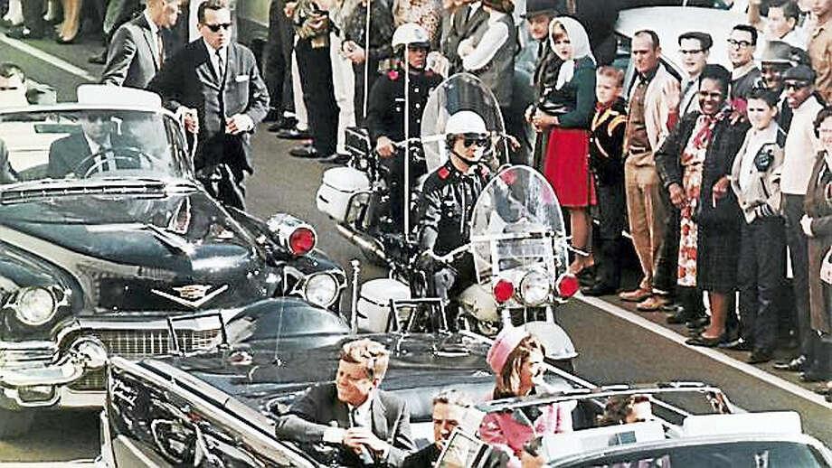 In this Nov. 22, 1963, file photo, President John F. Kennedy's motorcade travels through Dallas. Photo: AP Photo/PRNewsFoto/Newseum, File