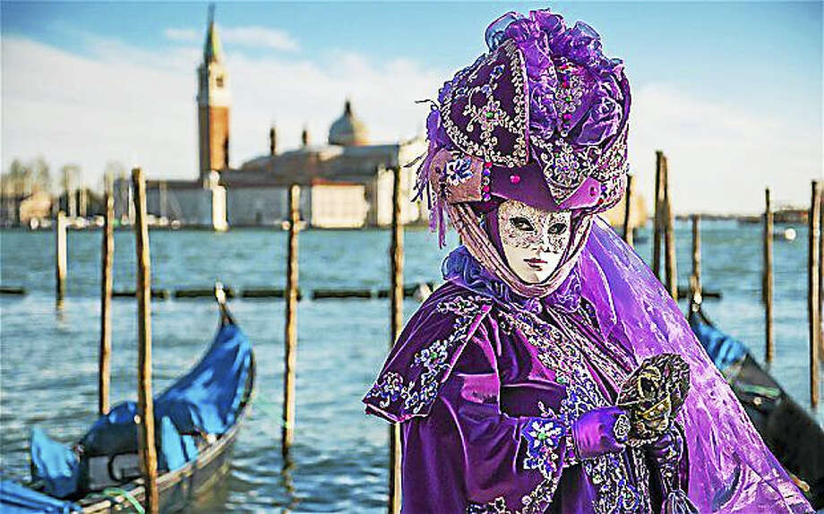 "A woman wears a traditional ""Carnevale"" costume in Venice, Italy. Photo: AP File Photo"