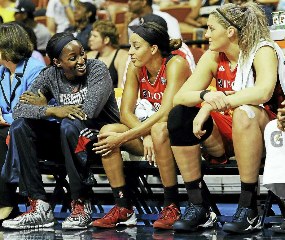 Former UConn standouts Bria Hartley, center, and Stefanie Dolson. Photo: The Associated Press File Photo  / AP2014