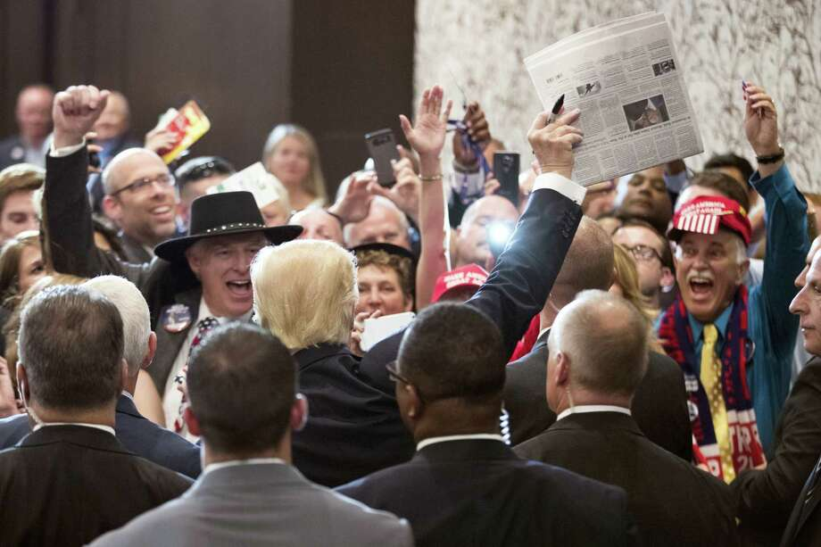 Republican presidential candidate Donald Trump celebrates with crowd members by holding up a copy of the New York Times during a goodbye reception with friends and family following the Republican National Convention Friday in Cleveland. Photo: THE ASSOCIATED PRESS  / Copyright 2016 The Associated Press. All rights reserved. This material may not be published, broadcast, rewritten or redistribu