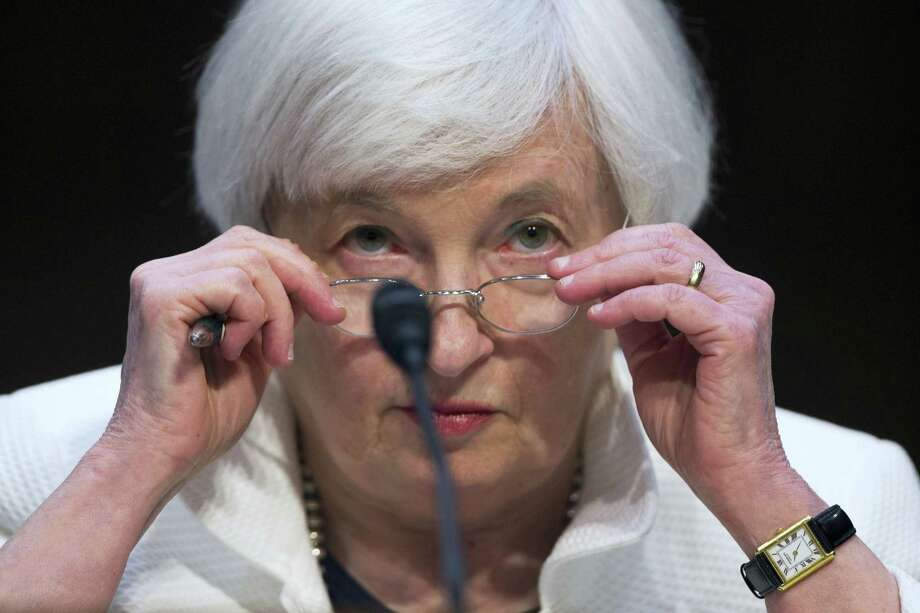 Federal Reserve Chairman Janet Yellen adjusts her glasses as she testifies on Capitol Hill in Washington, D.C., in June. Photo: THE ASSOCIATED PRESS File Photo  / Copyright 2016 The Associated Press. All rights reserved. This material may not be published, broadcast, rewritten or redistribu