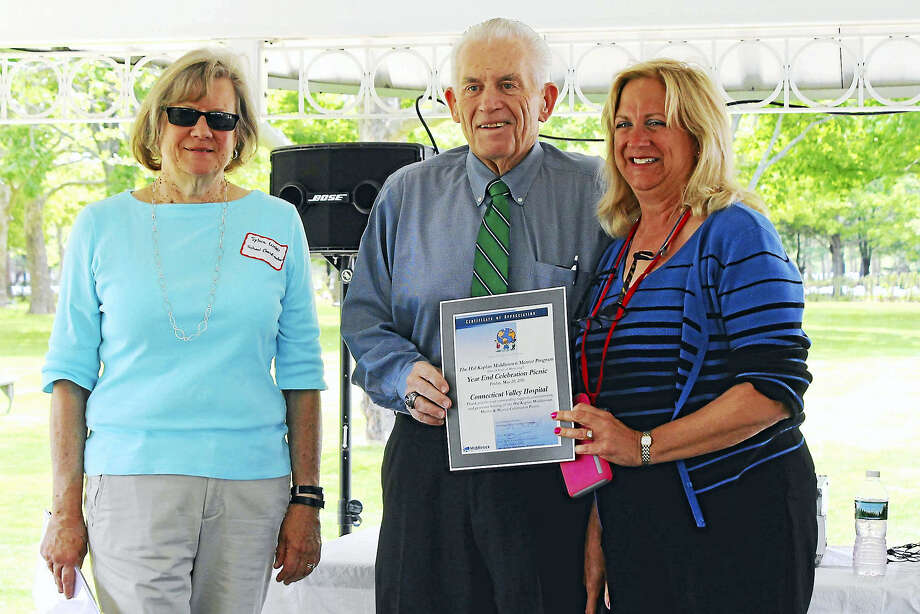 The Hal Kaplan Middletown Mentor Program held its end-of-the-year celebration picnic on the grounds of Connecticut Valley Hospital, where mentors connected with their mentee over lunch and during activities. From left are schools mentor coordinator Sylvia Webb, Middlesex County Chamber of Commerce President Larry McHugh and Chief Operating Officer of Connecticut Valley Hospital Helene Vartelas. Photo: Contributed Photo