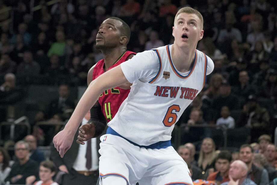 New York Knicks forward Kristaps Porzingis (6) and Atlanta Hawks forward Paul Millsap (4) fights for position during a free throw in the second half of an NBA basketball game on Sunday, Nov. 20, 2016 at Madison Square Garden in New York. The Knicks won 104-94. Photo: AP Photo/Mary Altaffer  / Copyright 2016 The Associated Press. All rights reserved.