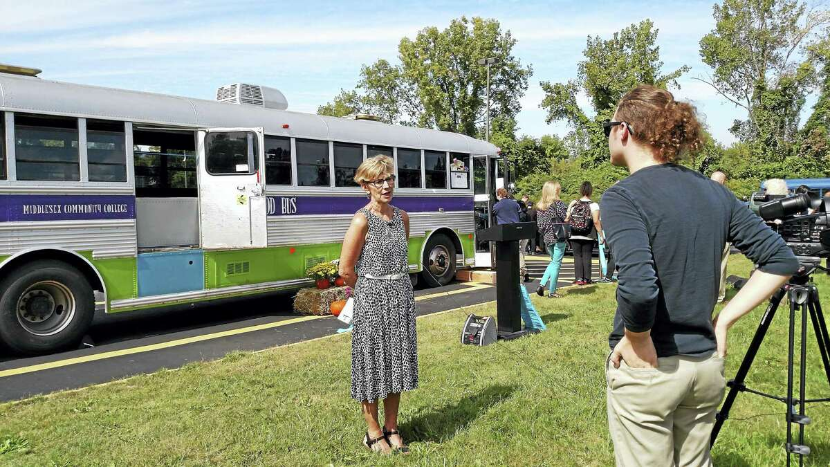 Middlesex Community College Professor Judith Felton speaks at the ribbon cutting for the Magic Food Bus on Sept. 21.