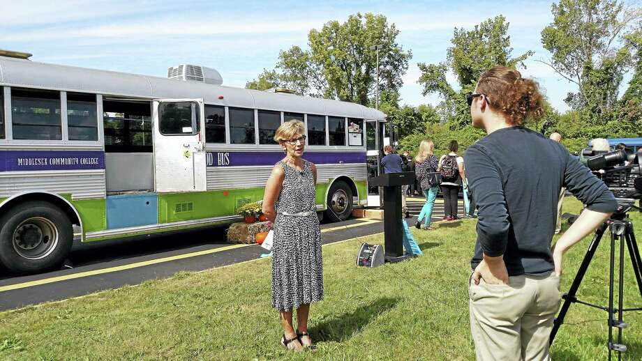 Middlesex Community College Professor Judith Felton speaks at the ribbon cutting for the Magic Food Bus on Sept. 21. Photo: Contributed Photo