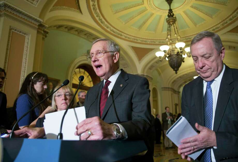 Senate Minority Leader Harry Reid, D-Nev., flanked by Minority Whip Dick Durbin, D-Ill., right, and Sen. Patty Murray, D-Wash., left, speaks with reporters at the Capitol in Washington on Jan. 27, 2016. Photo: AP Photo/J. Scott Applewhite  / AP