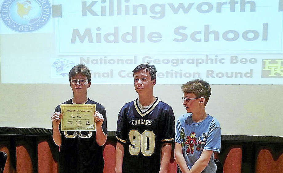 On Friday, Jaden, Colin and Riley Mack placed first, second and third among eight finalists in the Haddam-Killingworth Middle School Geography Bee sponsored by National Geographic. Photo: Courtesy Photo