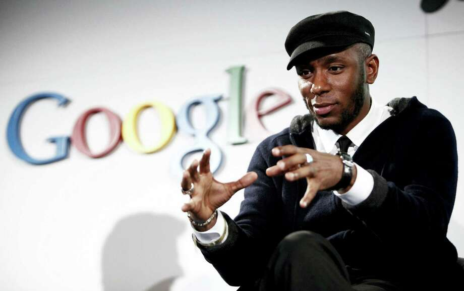 In this Oct. 28, 2009 photo, musician Mos Def speaks on a panel discussing Google's new music search in Los Angeles. The American entertainer has been charged with using a false identity, using an unrecognized travel document and helping his family stay in the country illegally, a Home Affairs official said on Jan. 20, 2016. Photo: AP Photo/Matt Sayles, File  / AP