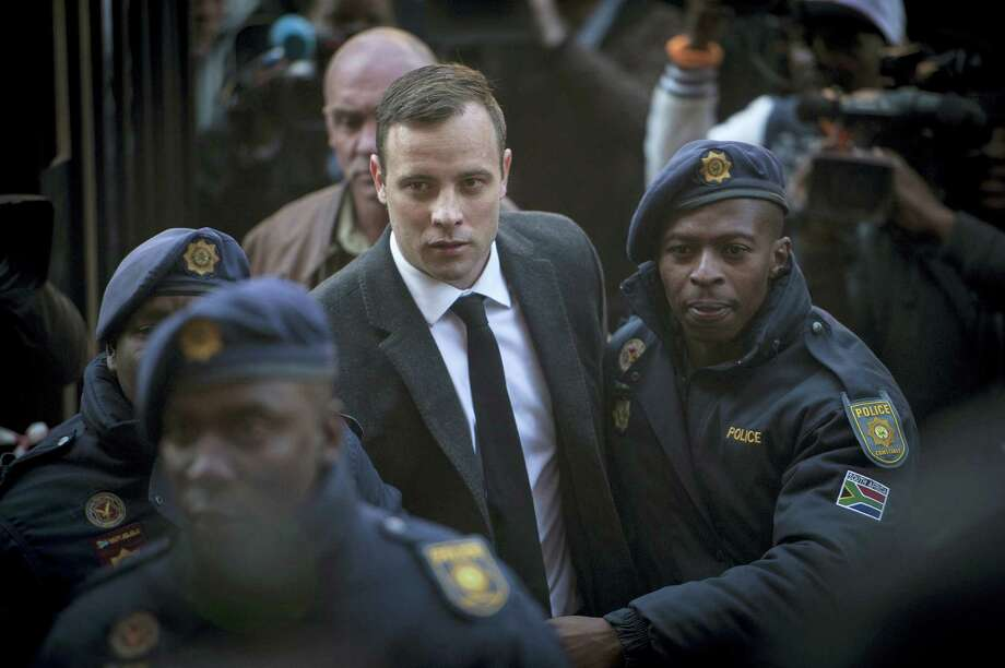 "In this July 6 2016 photo, Oscar Pistorius, center, arrives at the High Court in Pretoria, South Africa where he was sentenced to six years for the the killing of his girlfriend Reeve Steenkamp. The National Prosecuting Authority says it is going to appeal the jail sentence, stating that it was ""shockingly too lenient"". Photo: AP Photo/Shiraaz Mohamed, File  / Copyright 2016 The Associated Press. All rights reserved. This material may not be published, broadcast, rewritten or redistribu"