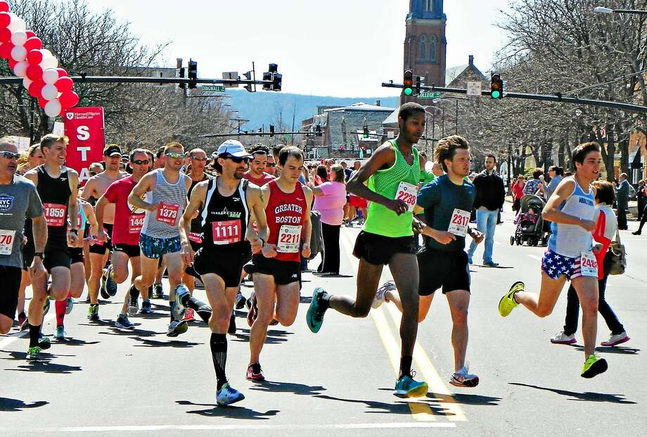 Shown here is the start of the 2015 Harvard Pilgrim Middletown Half & Legends 4-Mile race. Half-marathon winner William Sanders (bib 1111) and 4-mile winner Rob Weston of Middletown (2238) lead the pack. Photo: File Photo