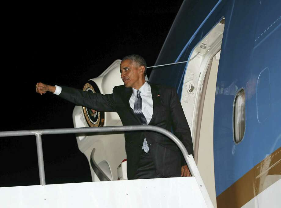 AP Photo/Pablo Martinez Monsivais President Barack Obama boards Air Force One during his departure at Jorge Chavez International Airport in Lima, Peru on Nov. 20, 2016. Obama is heading back to Washington after traveling to South America to attend the annual Asia-Pacific Economic Cooperation (APEC) forum. Photo: AP / Copyright 2016 The Associated Press. All rights reserved.