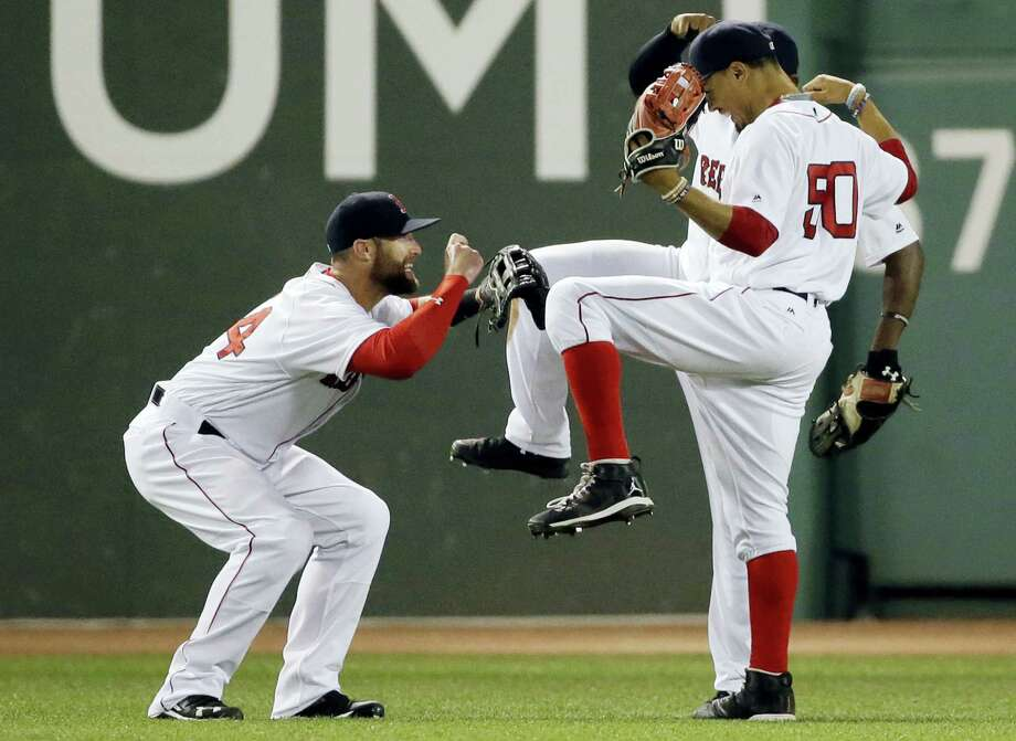 Red Sox outfielder Bryce Brentz, left, celebrates with Mookie Betts (50) and Jackie Bradley Jr. after beating the Twins 13-2 on Thursday. Photo: Elise Amendola — The Associated Press  / AP