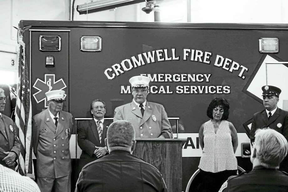 Frank Seidel, president of the Cromwell Board of Fire Commissioners, Commissioner/former chief Donald Swanson, Commissioner Charles Epstein, Chief Michael R. Terenzio, his wife Judy Terenzio and their son Michael Terenzio listen as the new top firefighter speaks. Photo: Courtesy Jay Polke