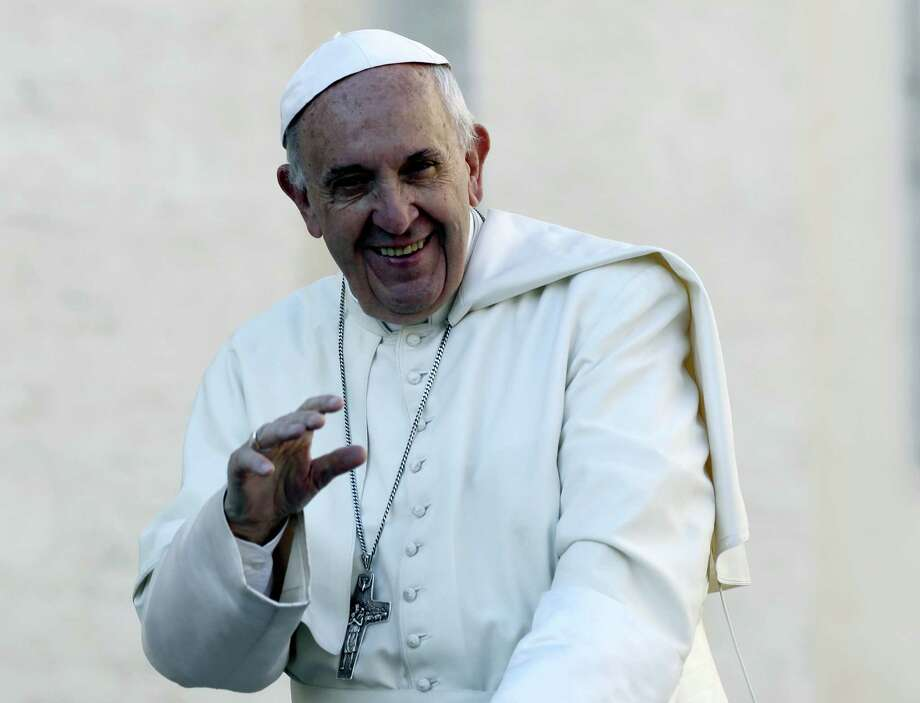 In this Oct. 19, 2016 photo, Pope Francis waves to the crowd as he is driven around St. Peter's Square ahead of his weekly general audience, at the Vatican. Photo: AP Photo/Alessandra Tarantino, File  / Copyright 2016 The Associated Press. All rights reserved.