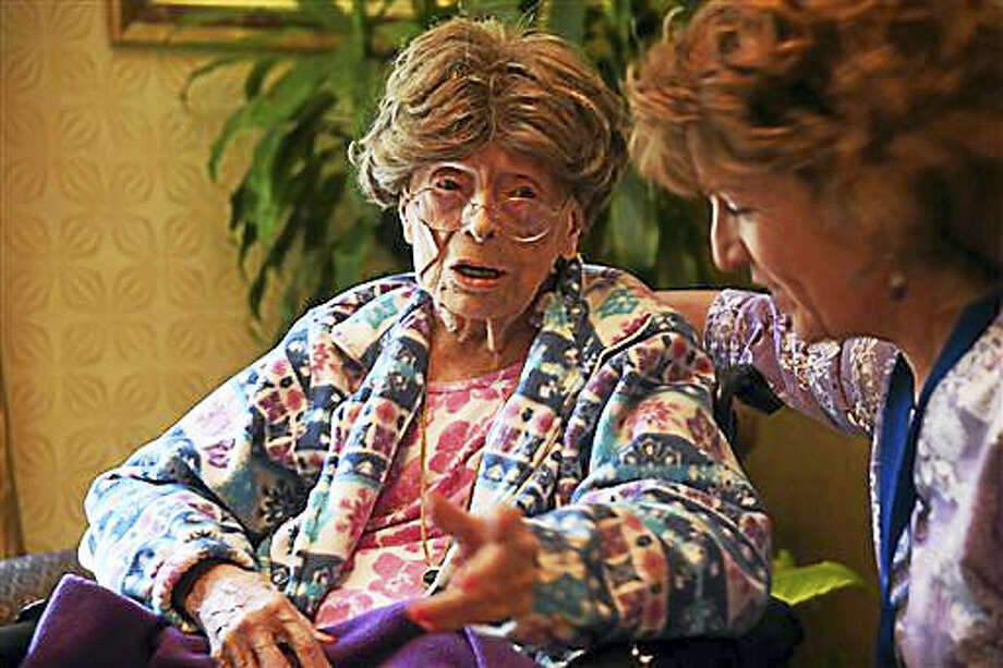 In this July 19, 2016, photo, Adele Dunlap, 113, talks with Susan Dempster, the activities director at Country Arch Care Center in Pittstown, N.J. Photo: Chris Pedota/The Record Of Bergen County Via AP   / Northjersey.com