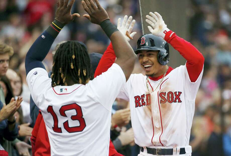 Mookie Betts, right, celebrates his grand slam with Hanley Ramirez (13) during the seventh inning. Photo: Michael Dwyer — The Associated Press  / Copyright 2016 The Associated Press. All rights reserved. This material may not be published, broadcast, rewritten or redistribu