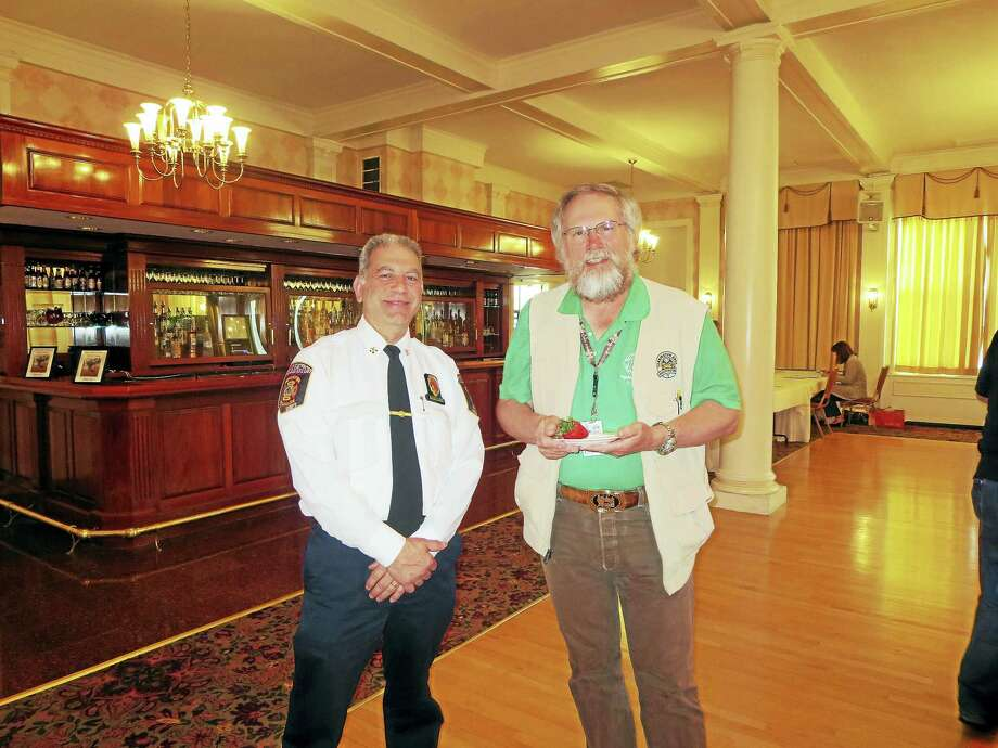 Contributed photos Guests at the Litchfield County Board of Realtors' recent event included Ed Bacetta, Torrington Fire Marshal and Bob Smith, Torrington Area Health District. Photo: Journal Register Co.